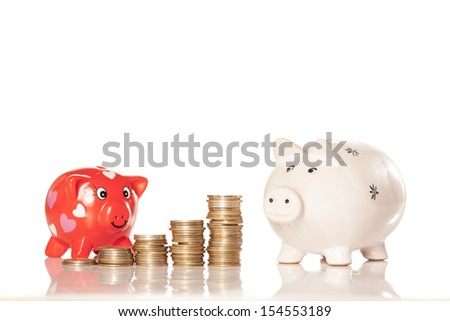 piggy banks with coins pillars next to them