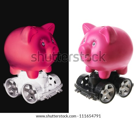 Piggy Banks with Wheels on White Background