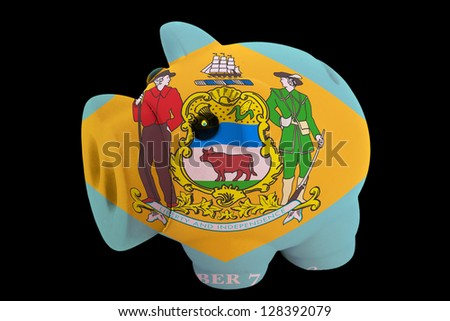 piggy rich bank in colors flag of us state of delaware for saving money on black background - stock photo