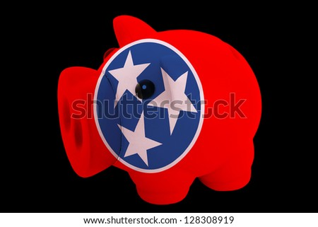 piggy rich bank in colors flag of us state of tennessee for saving money on black background