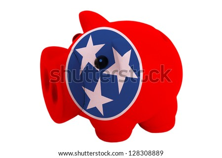 piggy rich bank in colors flag of us state of tennessee for savings on white background