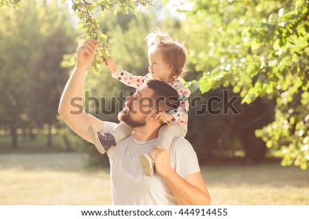 Piggyback of baby and dad - stock photo