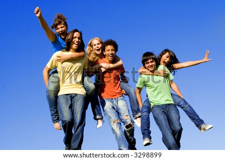 piggyback race diverse group of teens teenagers at summer camp - stock photo