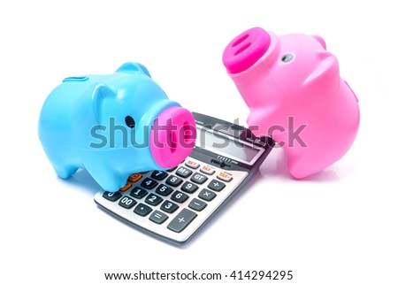 Piggybank and calculator isolated on white background - concept for calculating finance - stock photo