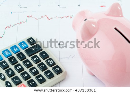 Piggybank and calculator on white background, stock market