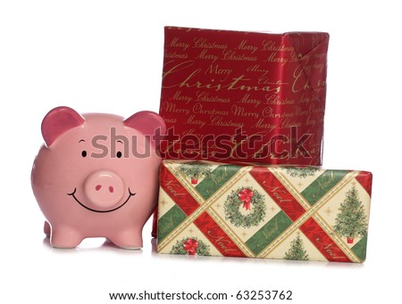 Piggybank and christmas presents studio cutout - stock photo