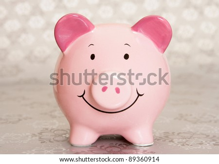Piggybank on silver christmas paper - stock photo