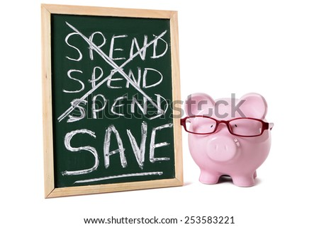 Piggybank saving plan concept : piggy bank, glasses, blackboard. - stock photo