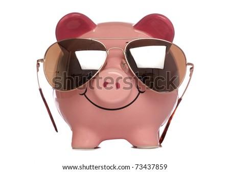 piggybank wearing sunglasses studio cutout - stock photo