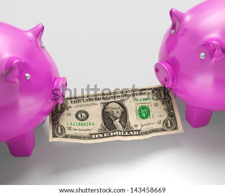 Piggybanks Eating Money Showing Monetary Loses Or Indecisions - stock photo