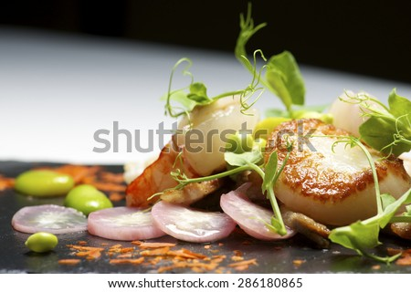 Piglet sauteed with scallops and prawns. - stock photo