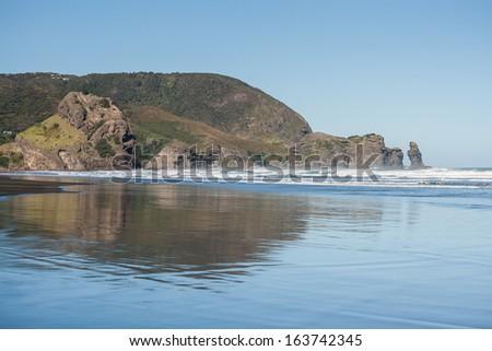 Piha beach at low tide - stock photo