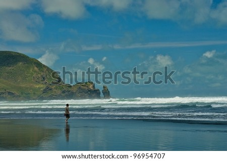 Piha beach looking south and surfing waves