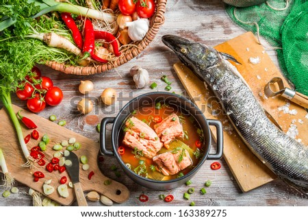 Pike and fresh vegetables for fish soup - stock photo