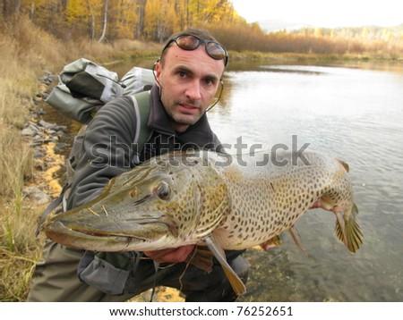Pike fishing - stock photo