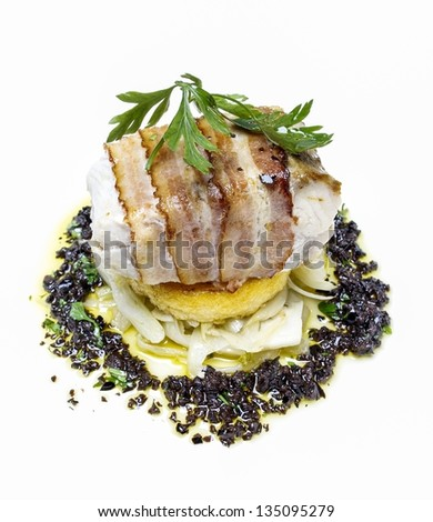 Pike perch wrapped with bacon. Latvian dish popular for special occasions and holidays, served in modern way. - stock photo