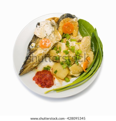 Pike prepared with vegetables and spices - stock photo