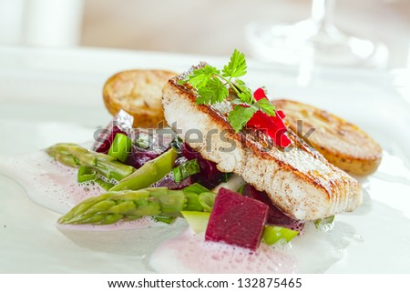 pikeperch fillet with asparagus beets ragout and potatoes - stock photo