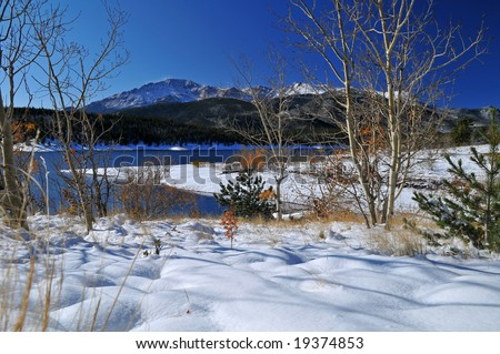 Pikes Peak at Crystal Reservoir near Colorado Springs, Colorado after an October white fluffy snowfall with Aspen Trees - stock photo