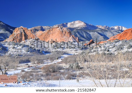 Pikes Peak Soaring over the Garden of the Gods near Colorado Springs, Colorado in Winter with deep blue sky - stock photo