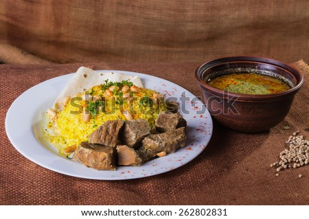 Pilaf cooked in Arabic. Pilaf with meat. Pilaf with special soup. Arab food. Eastern food. - stock photo