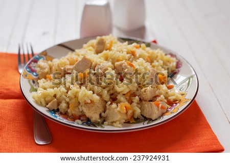 Pilaf in bowl  on wooden table. Selective focus.