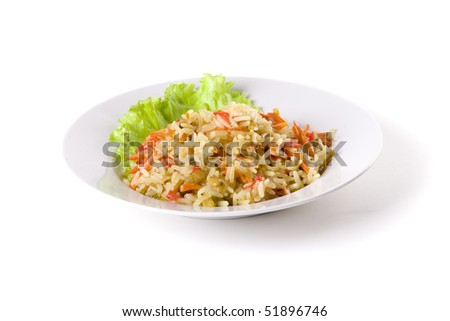pilaf on plate decorated with leaf on white ground - stock photo