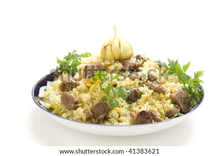 pilaf with garlic and parsley on white gound - stock photo