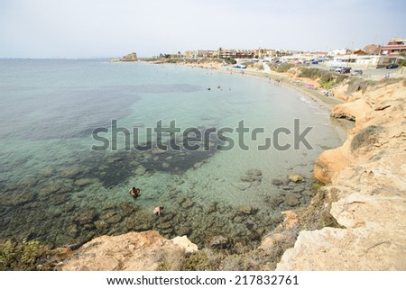 PILAR DE LA HORADADA, SPAIN - SEPTEMBER 16, 2014: Pilar de La Horadada is a municipality in Spain, province of Alicante. The beaches that are so popular town are located along the coast.Playa Jesuitas - stock photo