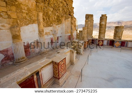 Pilasters and columns, plastered and painted with frescos at the lower terrace of the palace of king Herod on the rock masada - stock photo