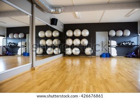 Pilate Balls Arranged In Shelves By Mirror - stock photo