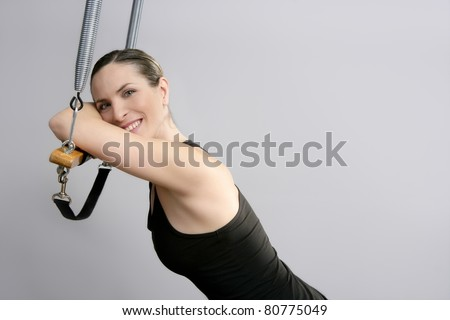 pilate instructor woman portrait in Cadillac trapeze - stock photo