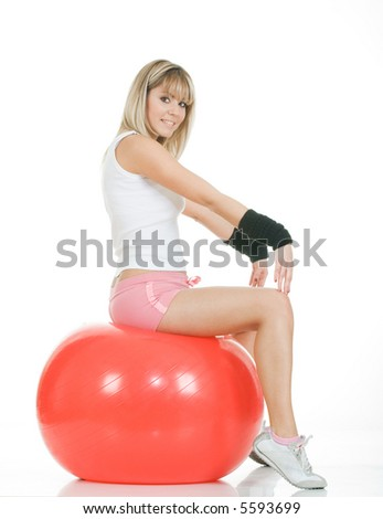 Pilates girl sitting on fitball. Pilates ball and woman concept - stock photo