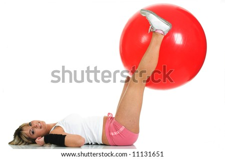 Pilates girl working on fit ball isolated. Pilates ball and fitness girl concept - stock photo