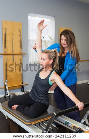 Pilates instruction - stock photo