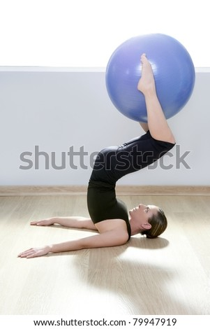 pilates instructor woman with stability ball doing gym fitness yoga exercises - stock photo