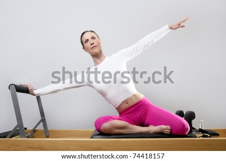 pilates reformer woman gym fitness teacher legs exercise - stock photo
