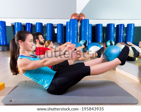 Pilates softball the teaser group exercise at fitness gym - stock photo
