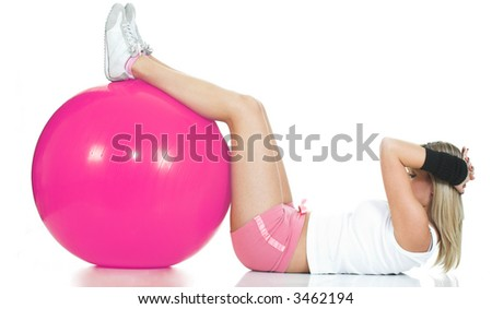 Pilates trainer doing stomach exercise. Pilates ball and fitness girl concept - stock photo
