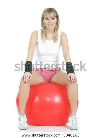 Pilates trainer sitting on fitball. Pilates ball and fitness girl concept - stock photo
