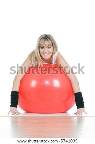 Pilates trainer sitting on fitball. Pilates ball and woman concept - stock photo