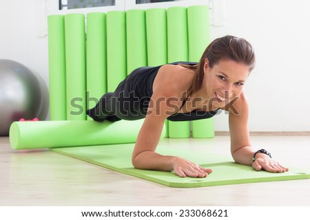 pilates training with roller - stock photo