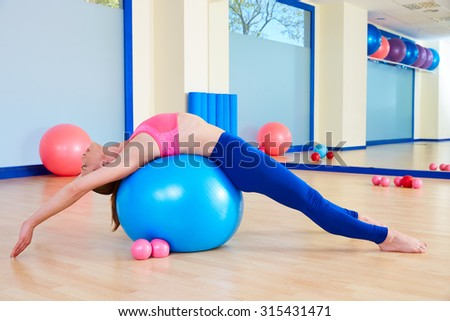 Pilates woman fitball swiss ball exercise workout at gym indoor