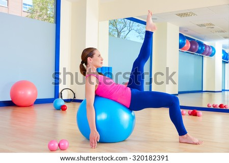 Pilates woman fitball swiss ball exercise workout at gym indoor - stock photo