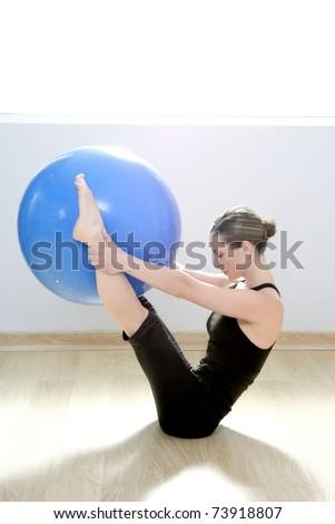 pilates woman stability ball gym fitness yoga exercises girl - stock photo