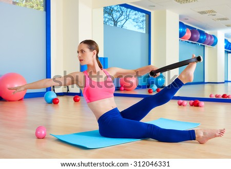 Pilates woman twist magic ring exercise workout at gym indoor