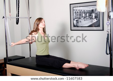Pilates Work on Trapeze Table - Cadillac Convertible - stock photo