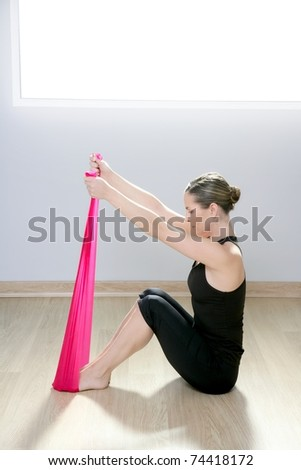 pilates yoga resistance band red rubber woman sport gym fitness exercise - stock photo