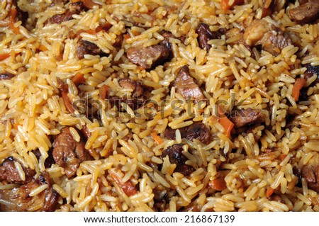 Pilau, pilaw, plov - a rice and meat meal macro - stock photo
