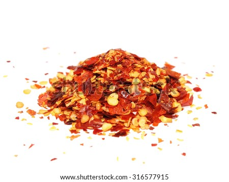 pile crushed red pepper, dried chili flakes and seeds isolated on white background - stock photo